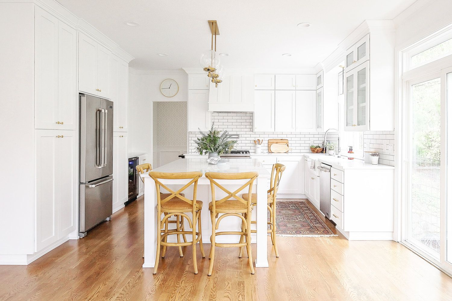 bright white kitchen with island seating | Industrial ...