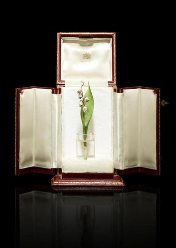 A jewelled gold, nephrite and rock crystal lily of the valley study Fabergé, St. Petersburg, circa 1900 in a cylindrical rock-crystal vase, with a carved nephrite leaf issuing a gold stem suspending seven pearls of varied size simulating buds, five mounted with platinum petals set with rose-cut diamonds imitating dew drops; in fitted Wartski presentation case height: 13cm (5 1/8in).