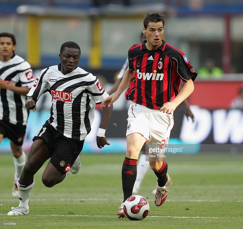 Yoann Gourcuff Of Milan And Obodo Of Udinese In Action During The Milan San Siro Stadium Ac Milan