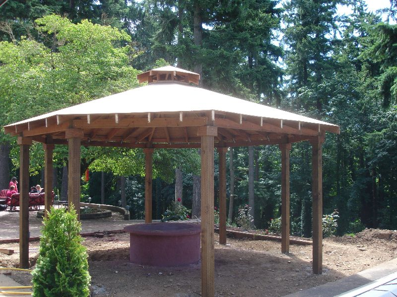 Custom gazebo with cedar shake roof and fire pit build for Outdoor gazebo plans with fireplace