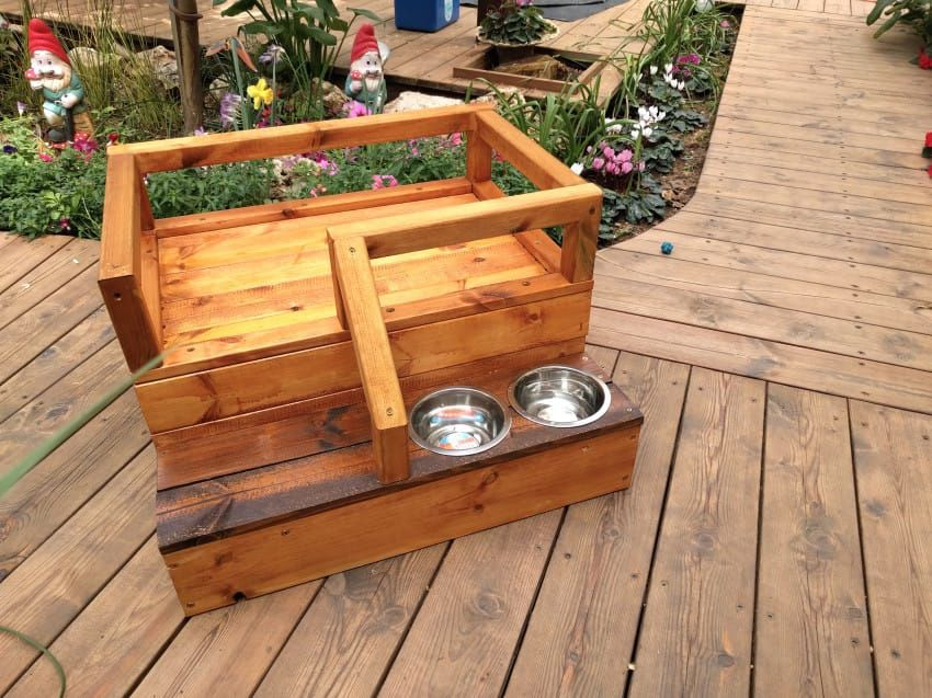 Crafty Dog Owner Builds A Pinewood Bed And Feeding Station For His