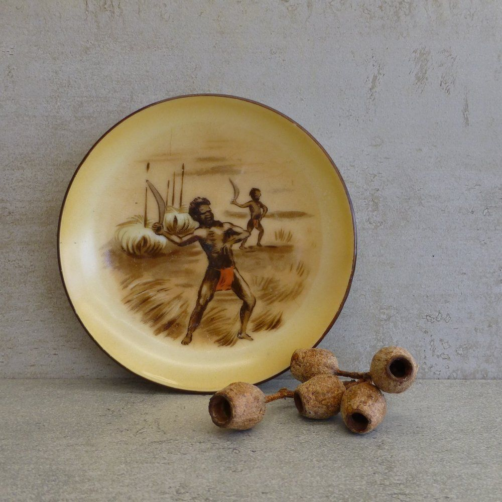 Vintage Small Decorative plate - with holes on back for wall hanging. Featuring two Indigenous & Vintage Small Decorative plate - with holes on back for wall hanging ...