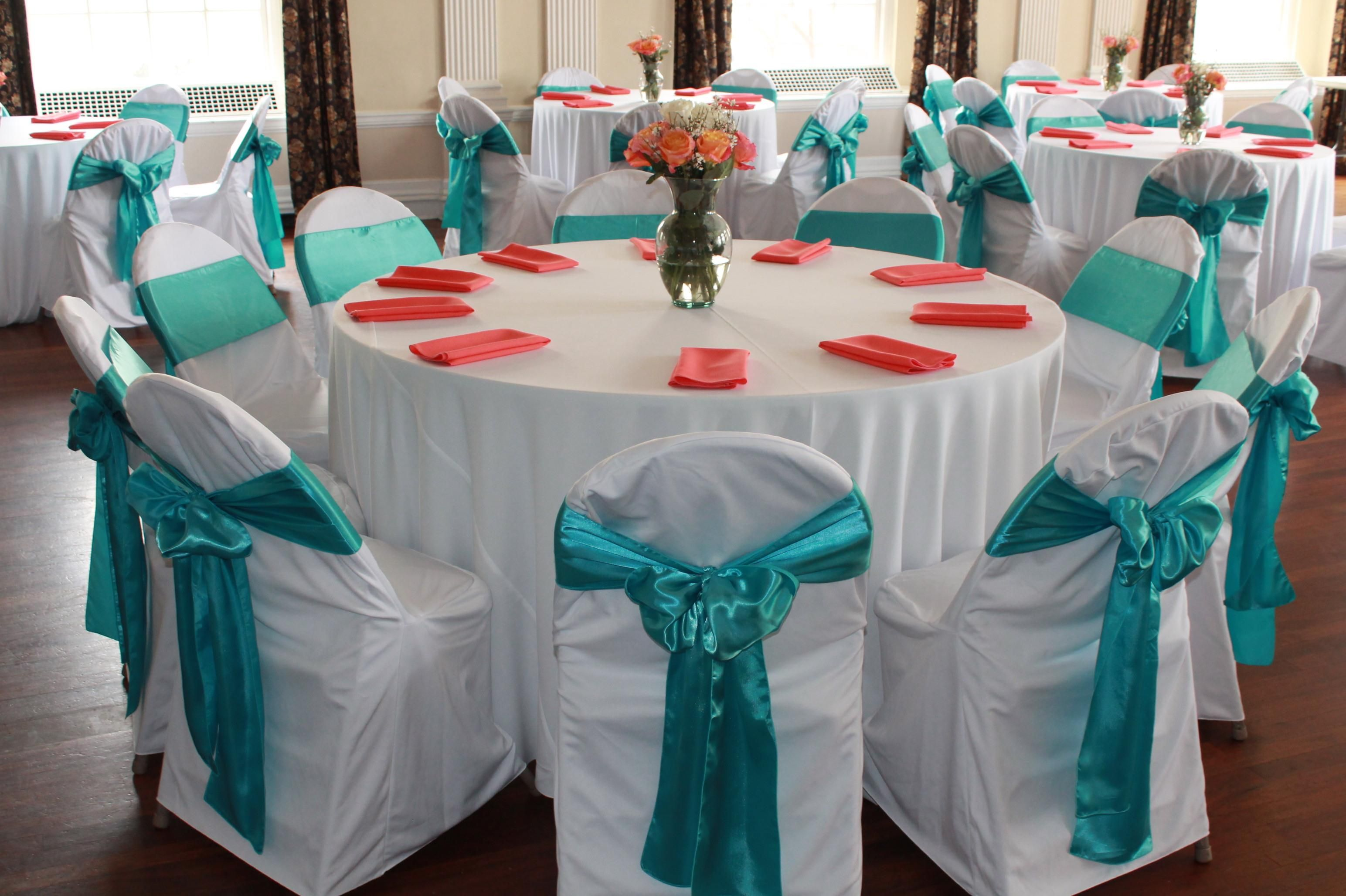 White polyester tablecloths and chair covers, coral
