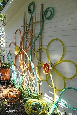 Hanging On The Outside Of The Shed Is This Flower Design Art Thingie   Made  Out Of Colored Hoses. The Middles Are Bundt Pans! Bachmanu0027s 2011 Summer  Ideas ...