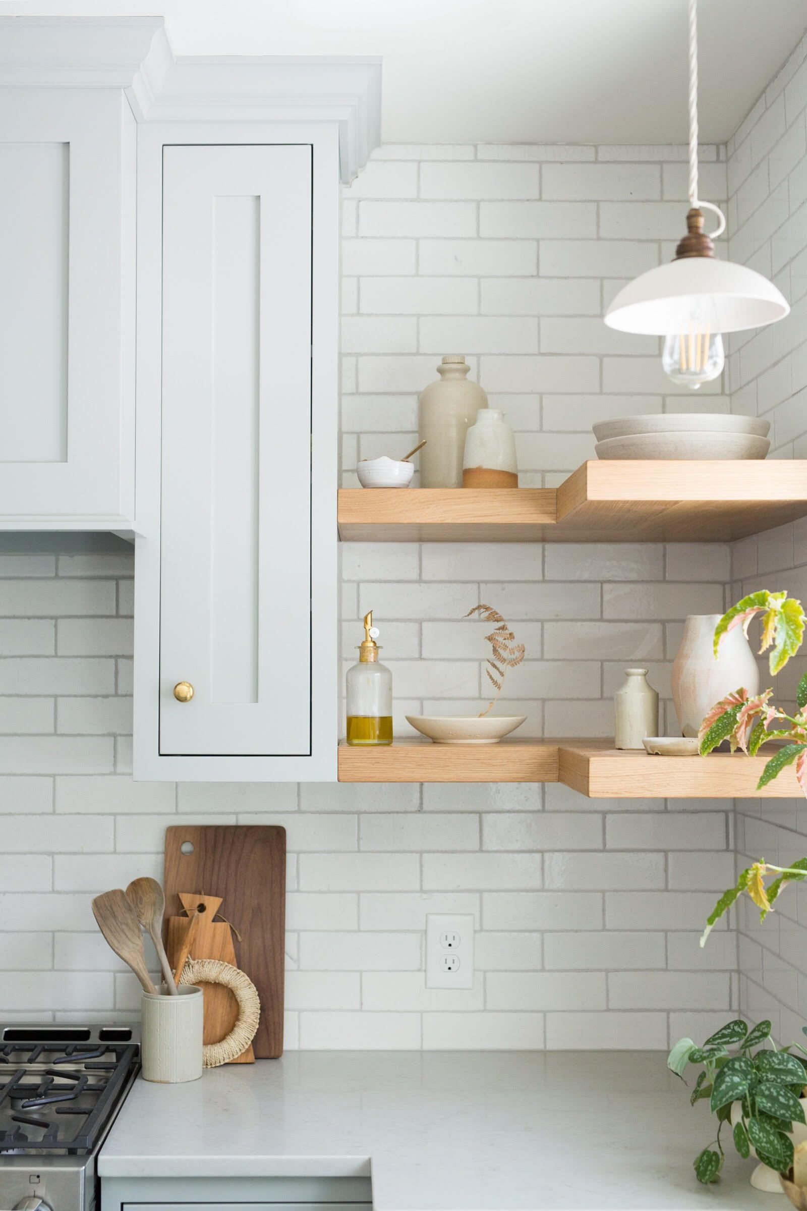 Traditional shaker cabinetry pair easily with our classic glazed thin brick in olympic