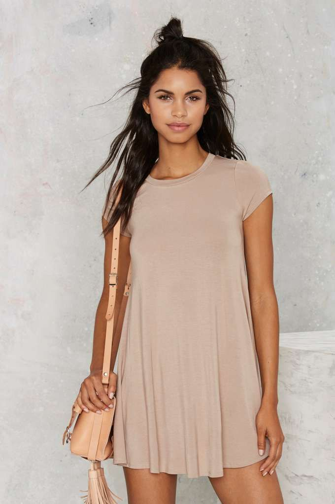 Go back to basics in this Nasty Gal Essential! It's a nude shirt dress with a crew neck, cap sleeves, and A-line silhouette.