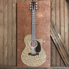 String Art Acoustic Guitar If you make an order, message me what colors you would like for the guitar or if you have a certain image or guitar you want me to do please send it to me or I will use the image and color shown in my pictures! Size is 2ft tall and 1ft wide.