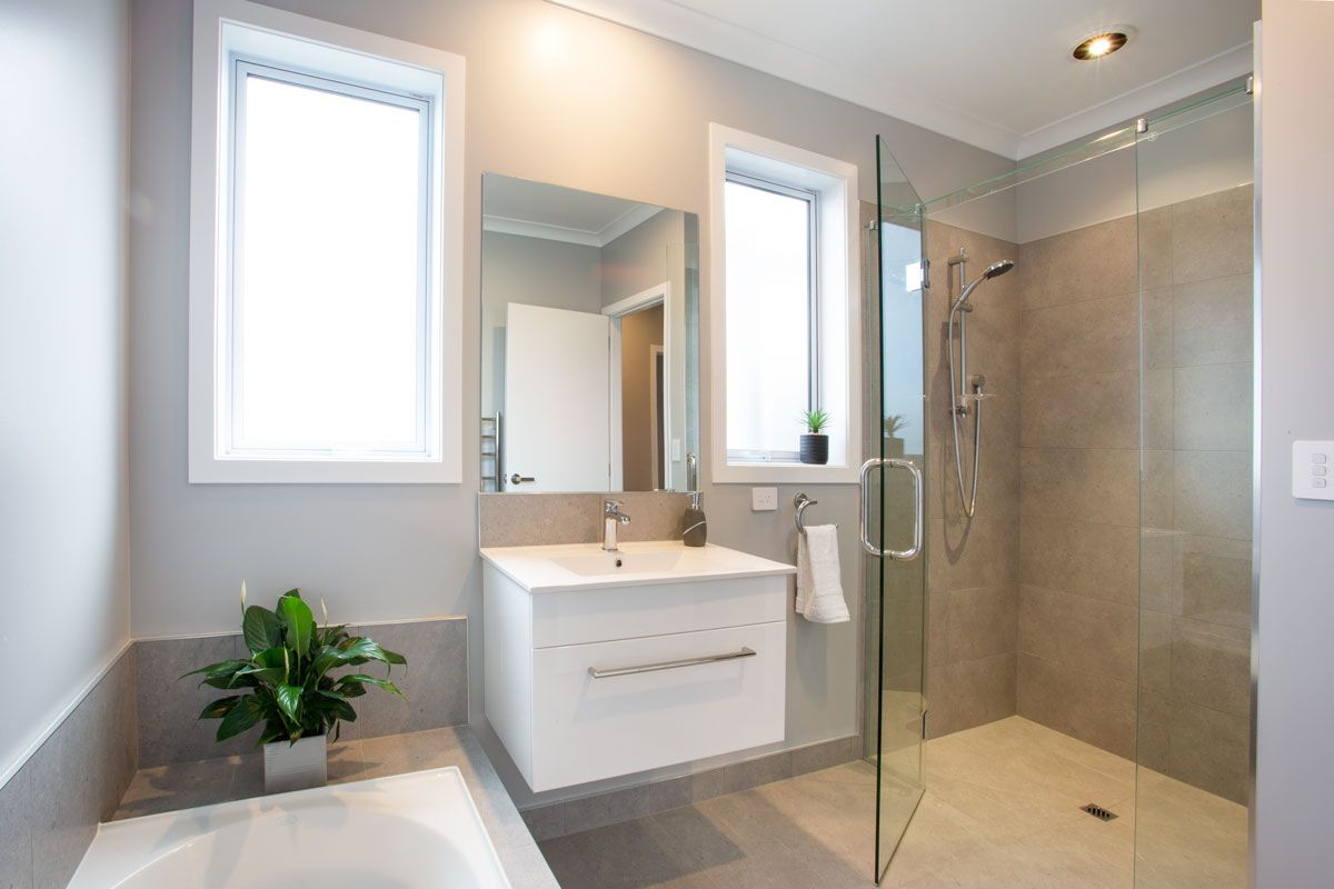 Grey Is The New Neutral Our Showhome Uses A Light Grey To Add Serenity To The Bathroom Bathroom 4 Bedroom House Plans Bedroom House Plans 4 Bedroom House