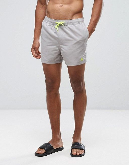 a03b4e11c3 ASOS Swim Shorts In Stone With Neon Yellow Triangle Logo Short Length
