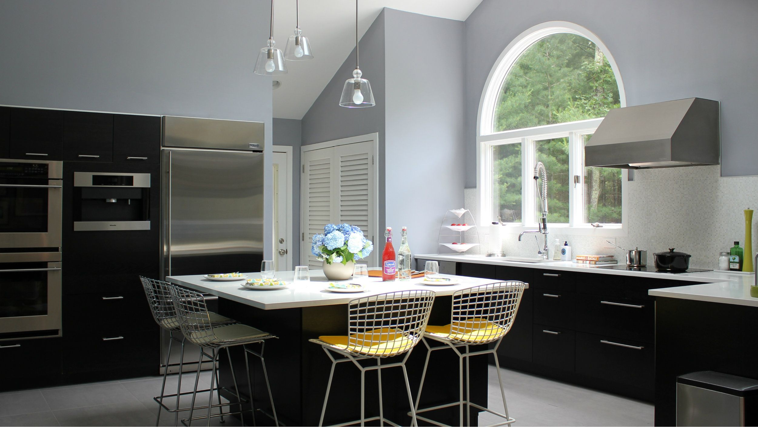 artemis lin design bright and airy kitchen with dark cabinets white counters large island on kitchen remodel timeline id=63921