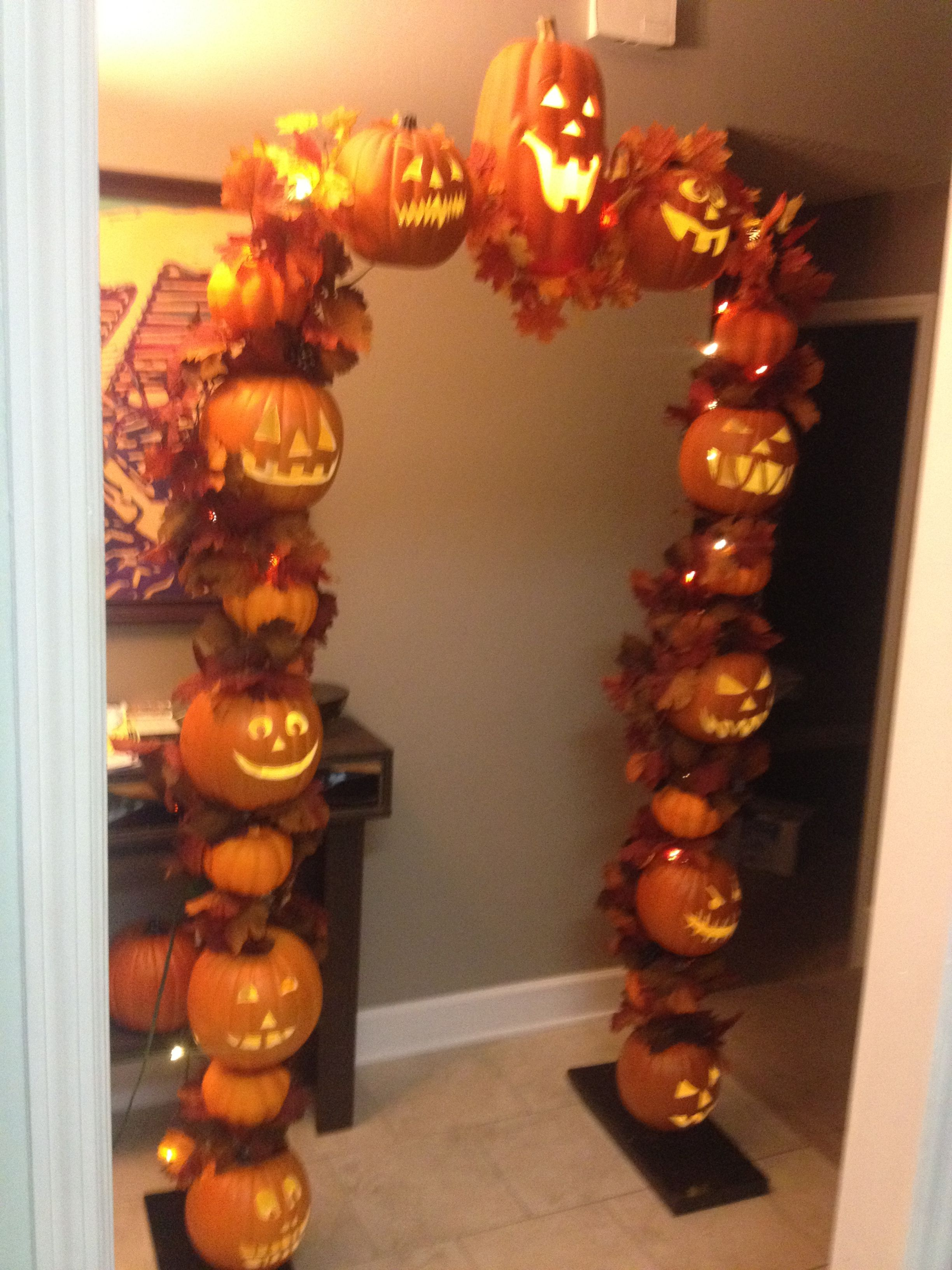 Fall jack o lantern arch made from PVC and foam pumpkins - Scary Door Decorations For Halloween