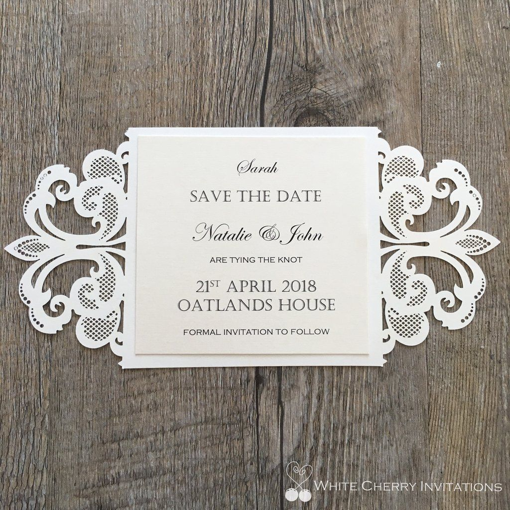 Laser cut save the date card made to match the Cinderella wedding invitation handmade by White Cherry Invitations.  Layered with ivory metallic card stock and accompanied with a DL size metallic ivory envelope.