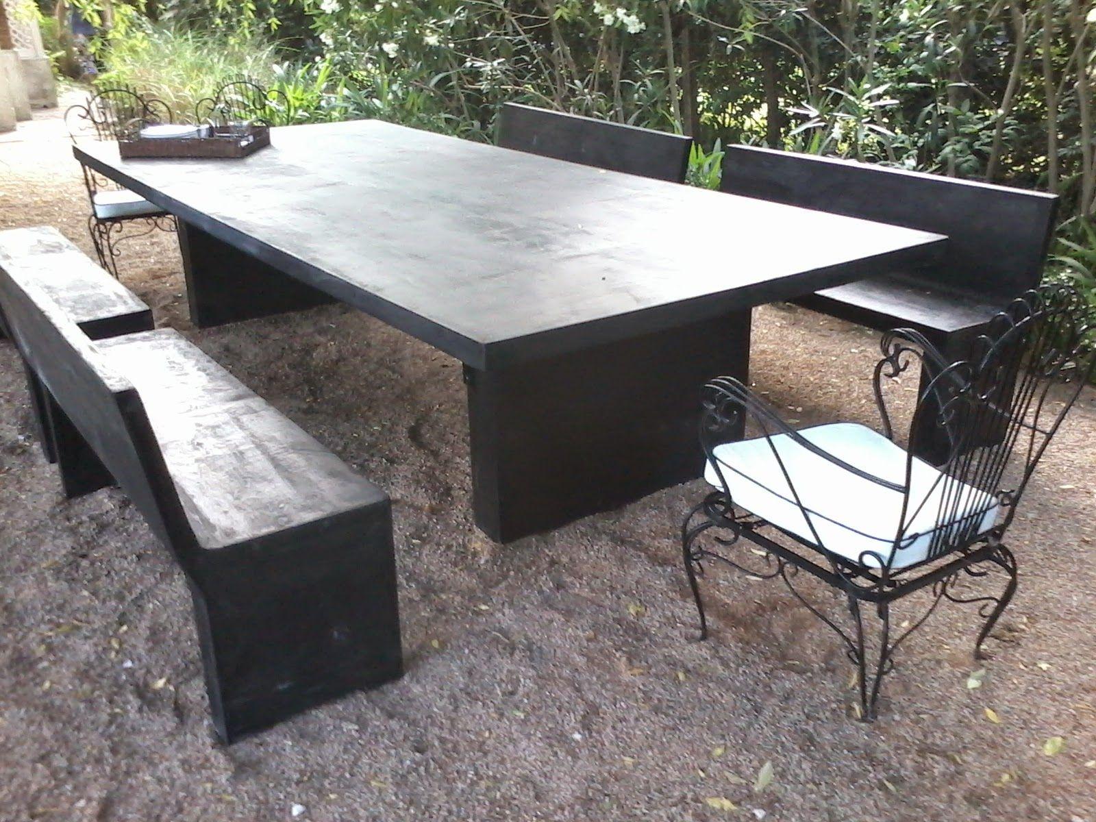 Mesa de comedor de cemento con sus respectivos bancos. Ideal para ...