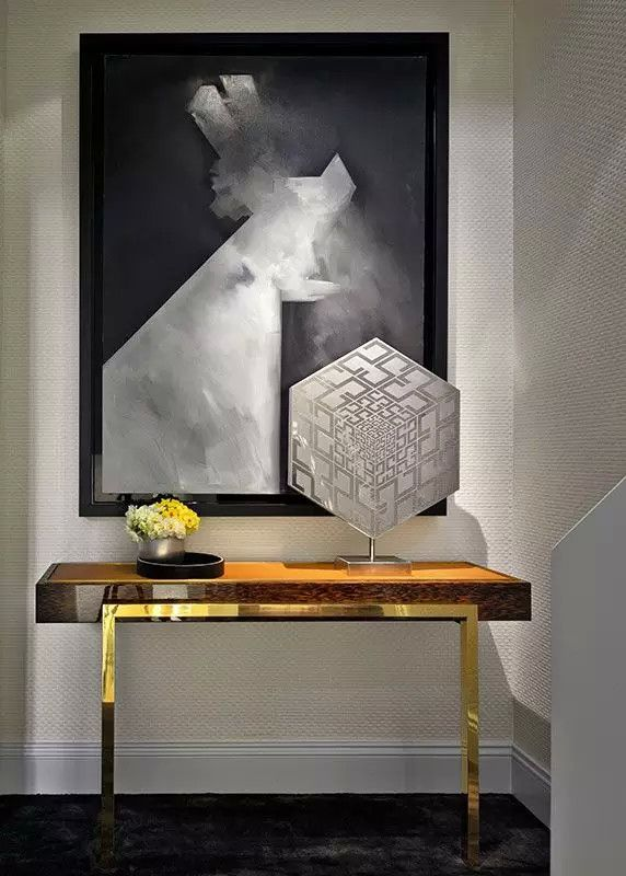 Ultra Modern Foyer With Large Art And Solid Wood And Gold Console
