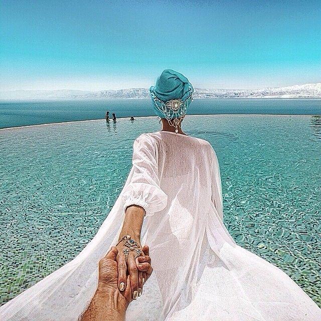 this guy takes breathtaking photos as he follows his girlfriend
