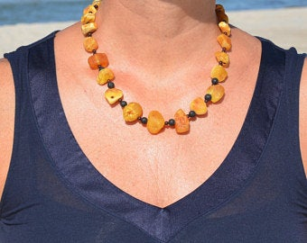 Amber jewelry from natural Baltic amber raw sea by