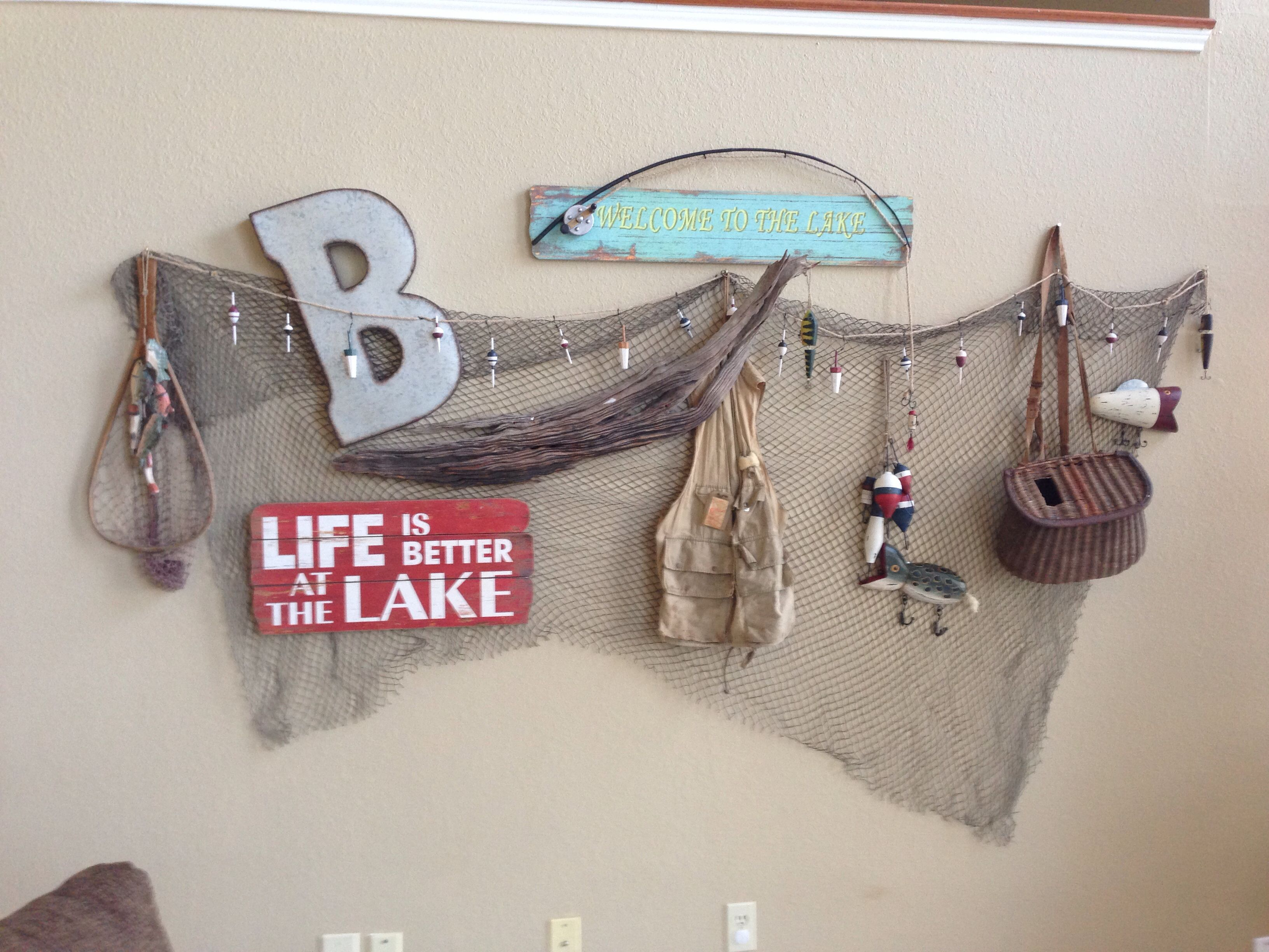 Lake House wall decor with fish net and fishing gear. 12/23/13