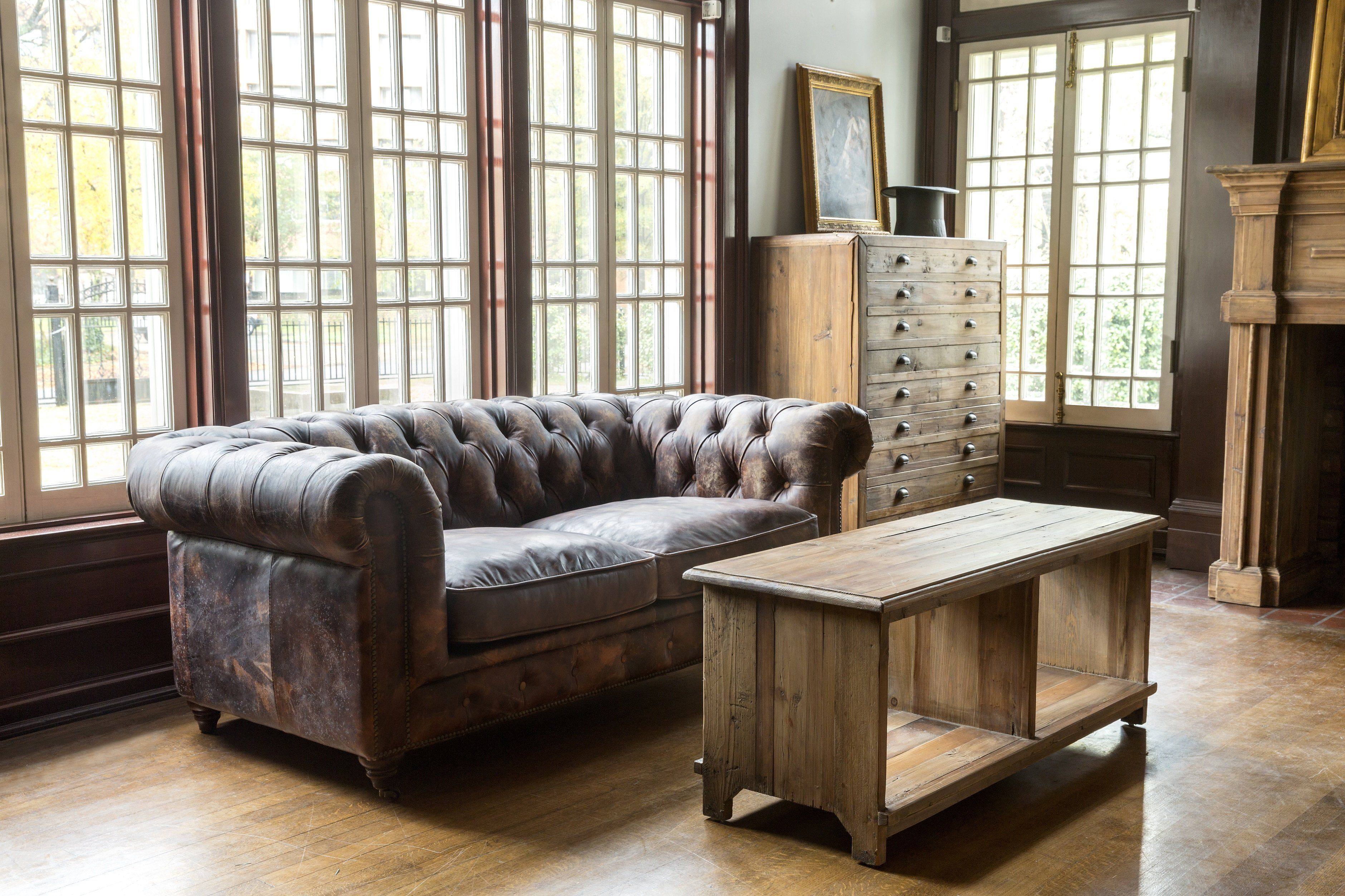 Aged leather cattlemans club sofa classic and dignifie d
