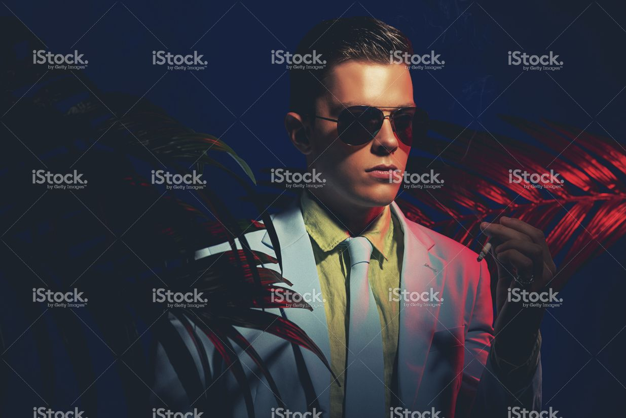 Elegant Guy with Sunglasses Holding a Cigarette stock photo 69300905 - iStock