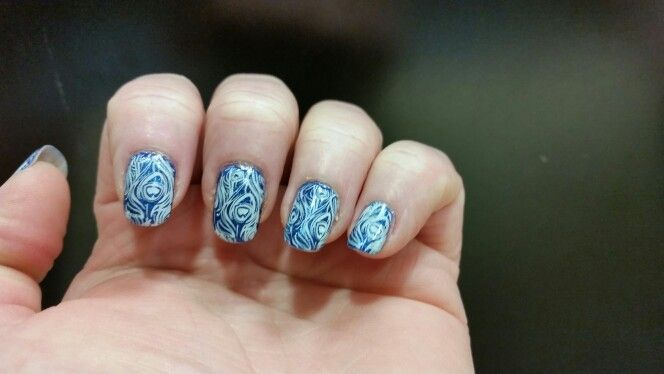 Blue holo mani with peacock feather stamp