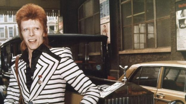 Bowie in his Ziggy Stardust phase, beside his vintage Rolls Royce