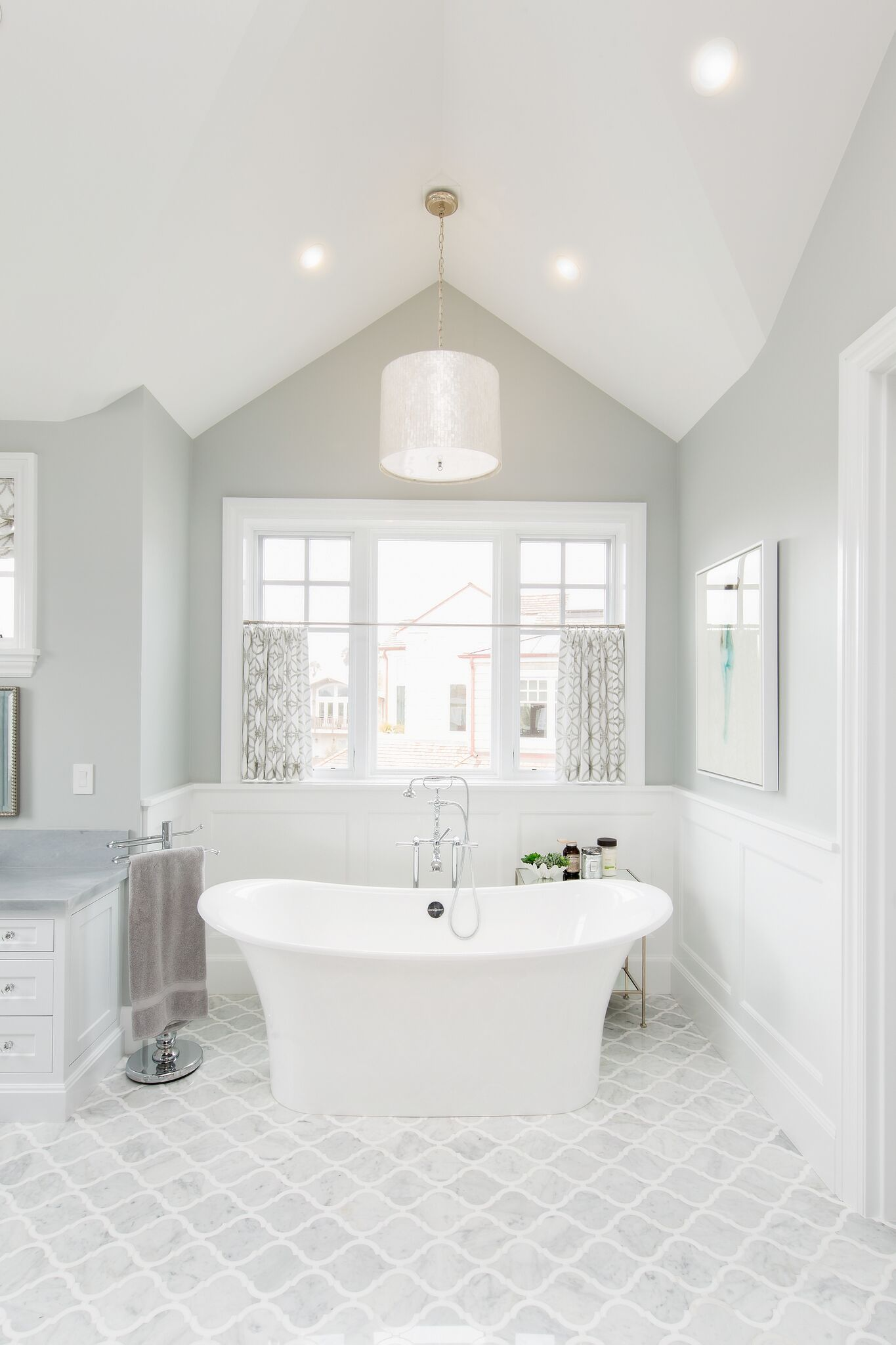 The Master Bathroom Features A Clic Grey And White Color Scheme