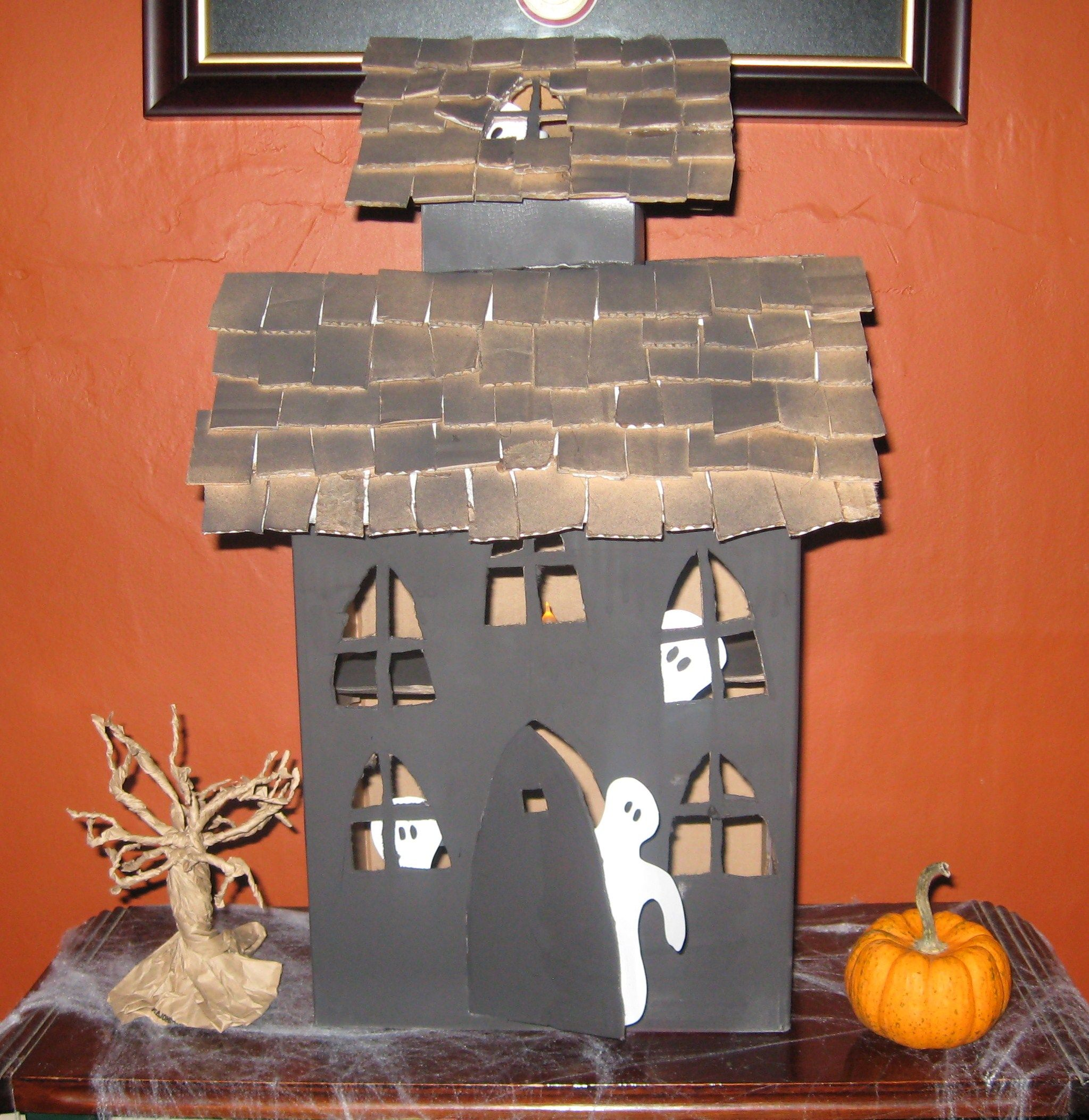 Haunted house. Shingles made out of card board box squares