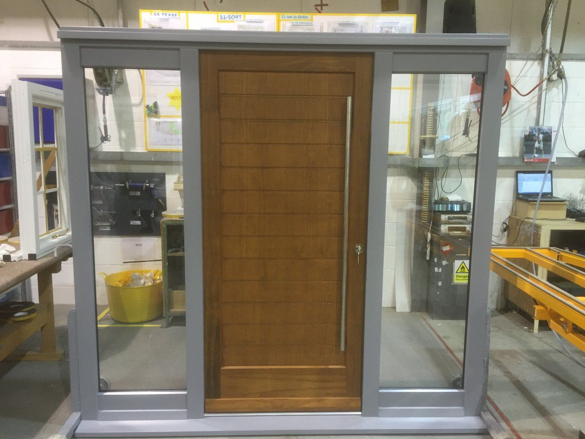 Contemporary timber entrance door set with fixed double-glazed ...