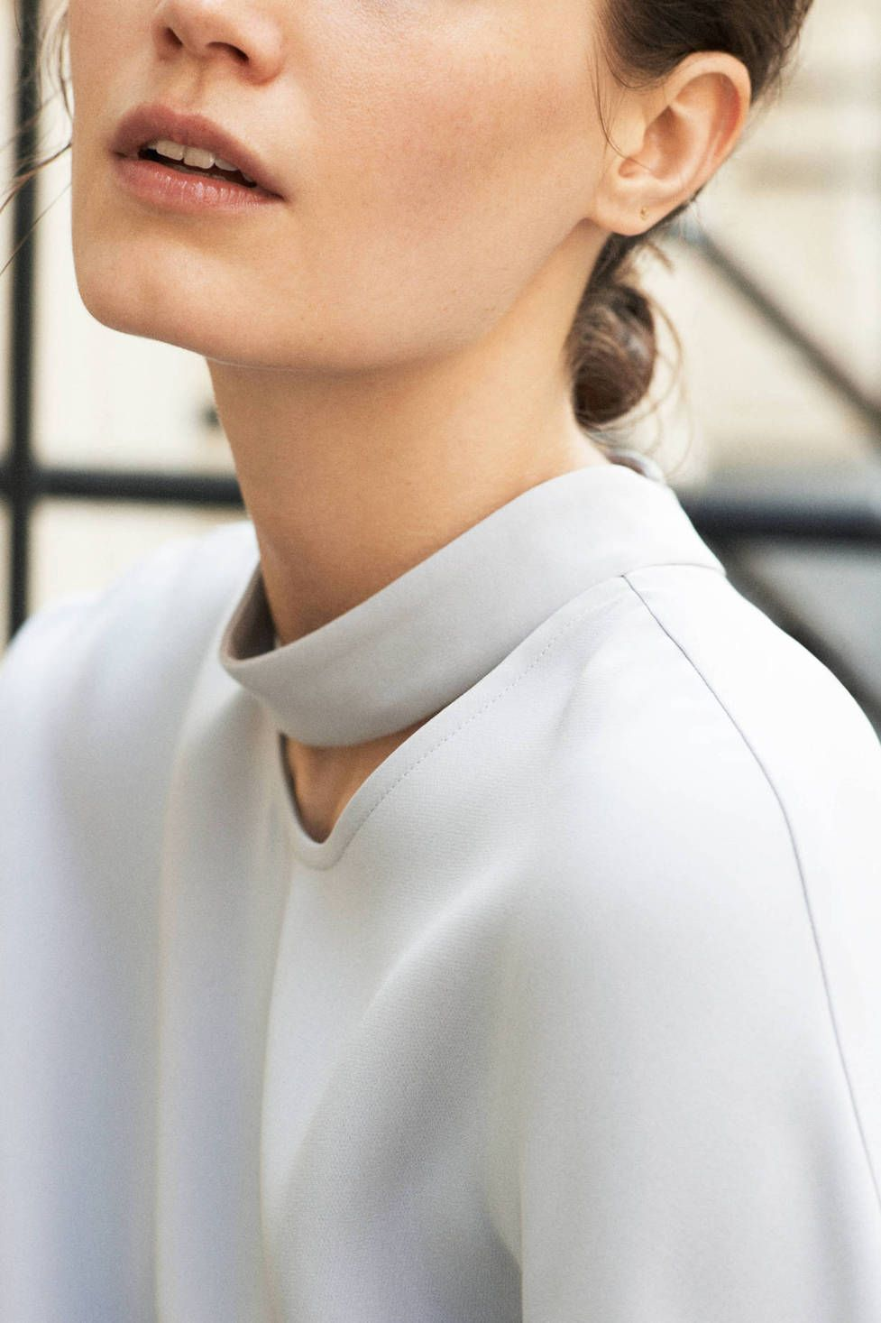 Protagonist's pale grey Shirt 04 combines a sleeveless silhouette with a deconstructed turtleneck neckline.