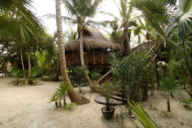 """""""Sueños Tulum is a small 12-room beachfront hotel built in an uniquely natural and mystical place, right on the Tulum beach, one and a half hours south of Cancun International Airport. This Mayan retreat was created to preserve the surrounding magic and feel of the area."""""""
