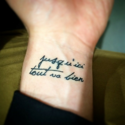 43 Wonderful Quote Wrist Tattoos: Little Wrist Tattoo Saying 'Jusqu'ici Tout Va Bien', Which