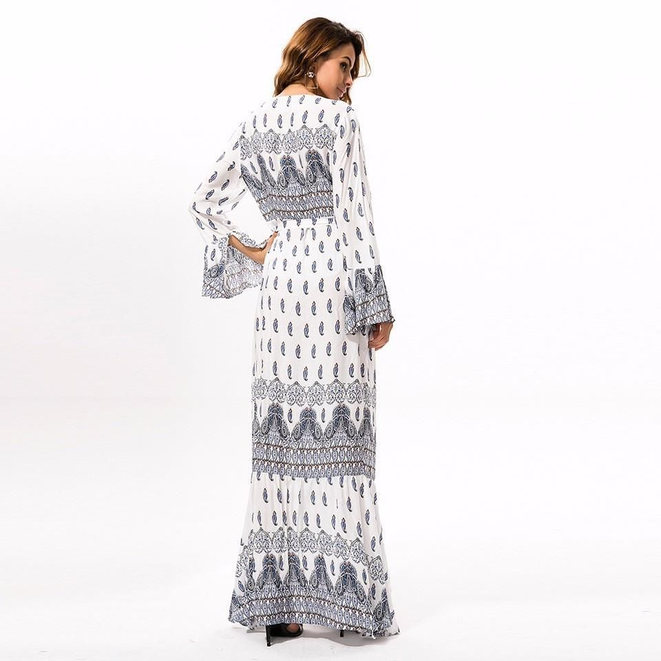 A woven maxi dress featuring bohemian prints side tie ribbons and