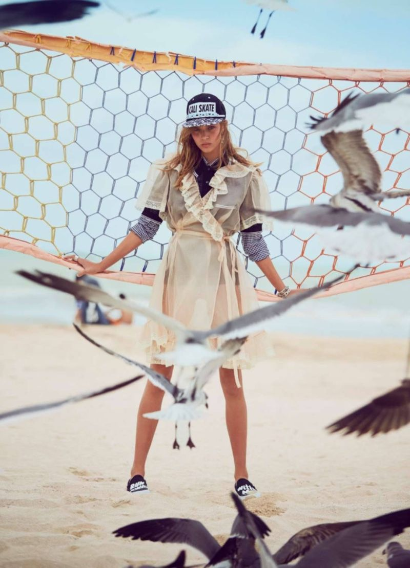 Hitting the sand, Josephine models a baseball cap with a Miu Miu sheer overcoat ELLE France Magazine March 2016 issue