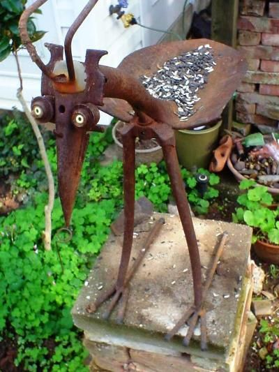 metal garden art from junk sue gerdess clever bird feeder bird made from old tools yard