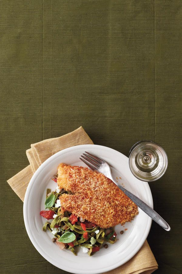 Crispy Oven-Baked Tilapia Recipe with Lemon-Tomato Fettucine - Fresh Catch: 8 Tilapia Recipes - Southernliving. From Tilapia Tacos to Bayou Fish Fillets, we've got you covered on all the ways to serve this delicious, flaky fish.  This is a quick and easy tilapia recipe that your entire family will love. We love how the bright flavor of the pasta complements the panko-breaded tilapia.  Recipe:Crispy Oven-Baked Tilapia with Lemon-Tomato Fettucine
