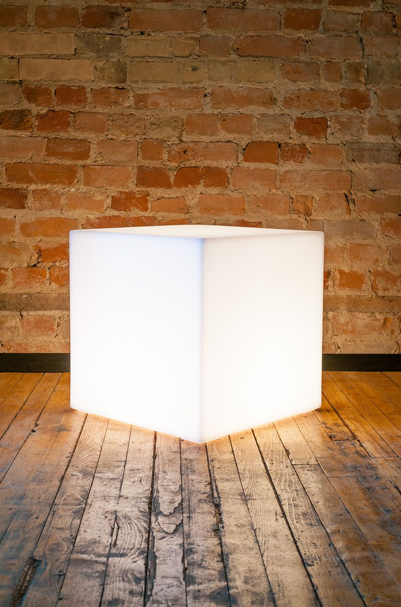 Gus modern the lightbox is a lamp a seat and an accent table all in one it casts a pleasing ambient light for interiors or covered exterior spaces