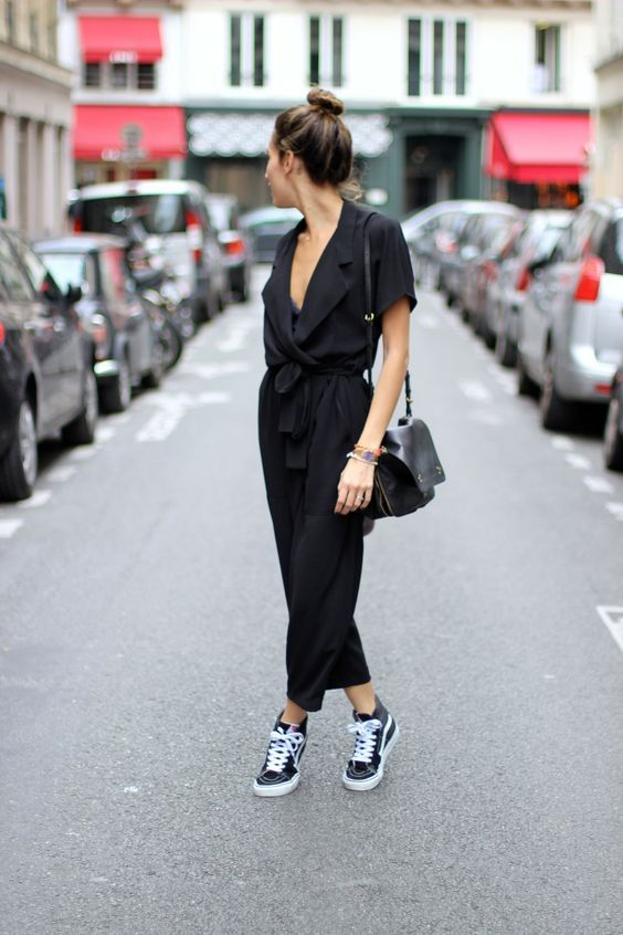 db71b545eed a black jumpsuit with a plunging neckline and black Vans