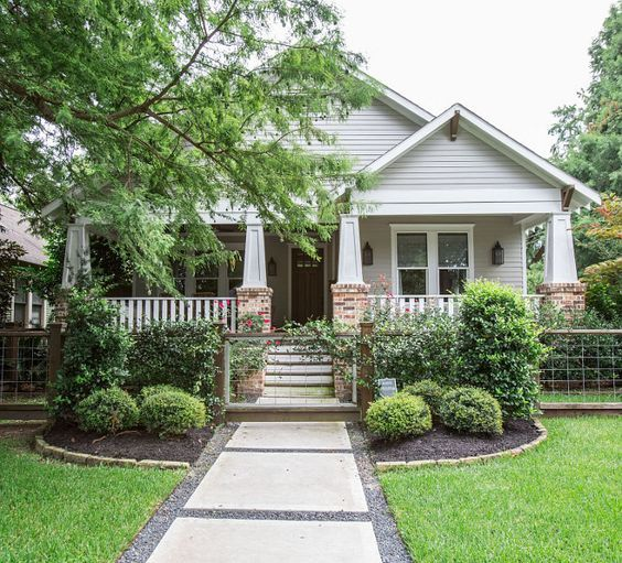 Restored 1920s American Craftsman style bungalow located in the Historic Heights District of Houston, Texas. The exterior of the home features custom shaker siding and custom millwork and trim - architectural details that are common in American Craftsman style homes. Marie Flanigan Interiors #craftsmanstylehomes