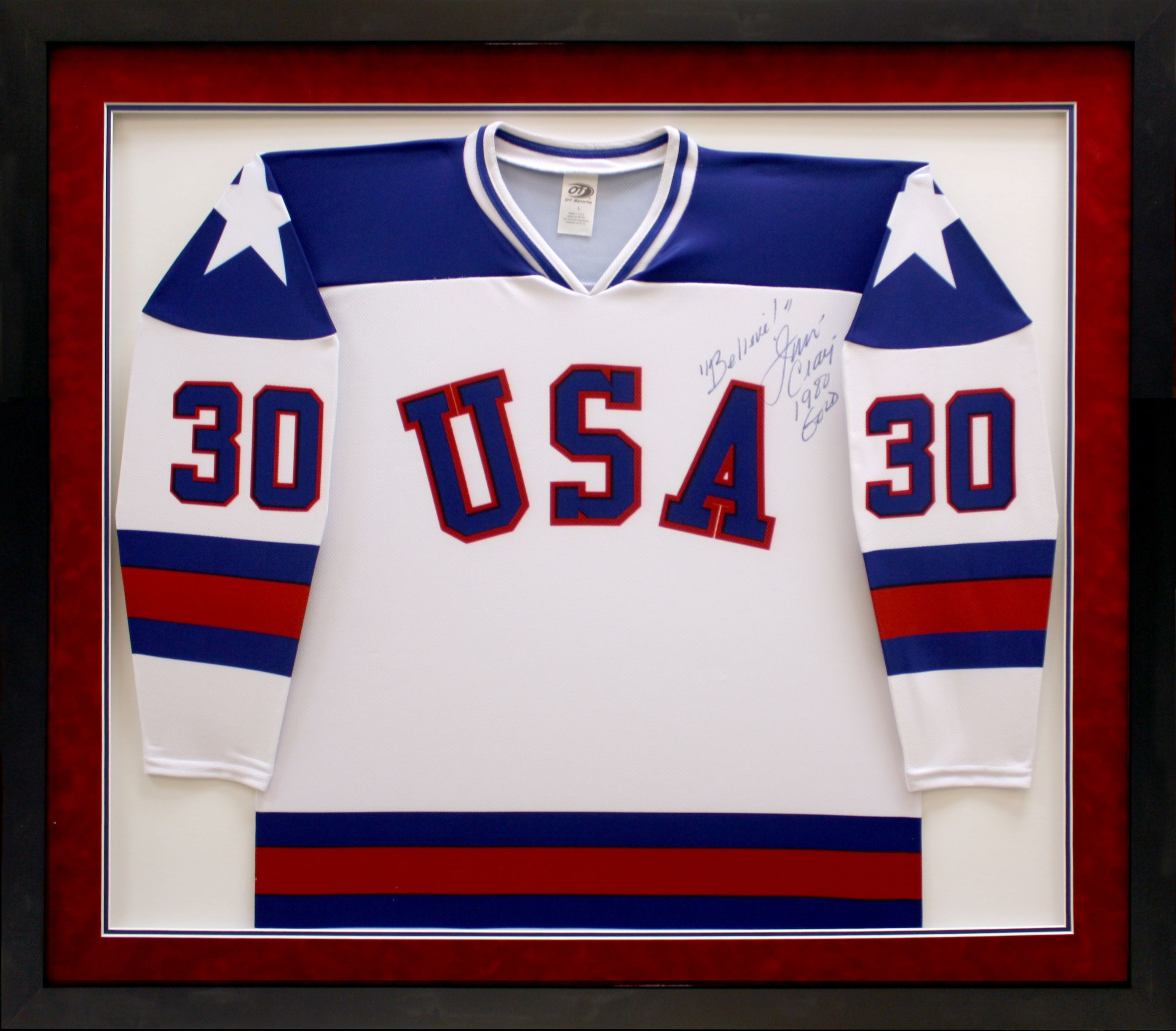 Hockey Jersey displayed in a black frame, with complementary blue ...