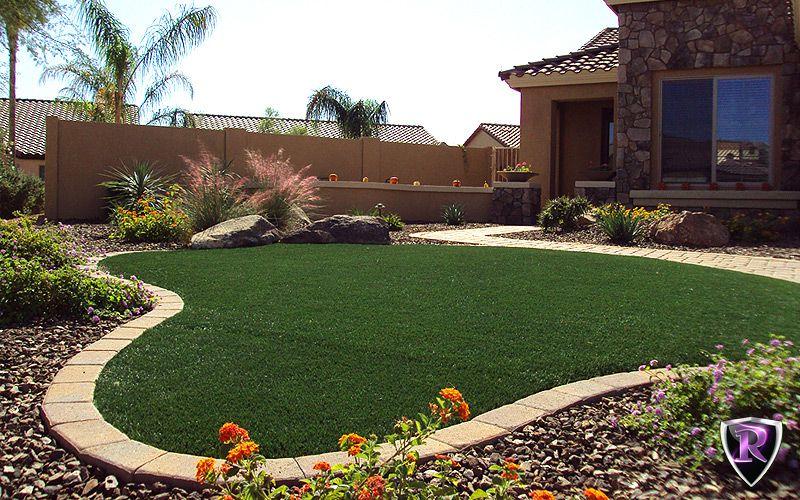 Backyard With Turf And Rock Border Desert Backyard Desert