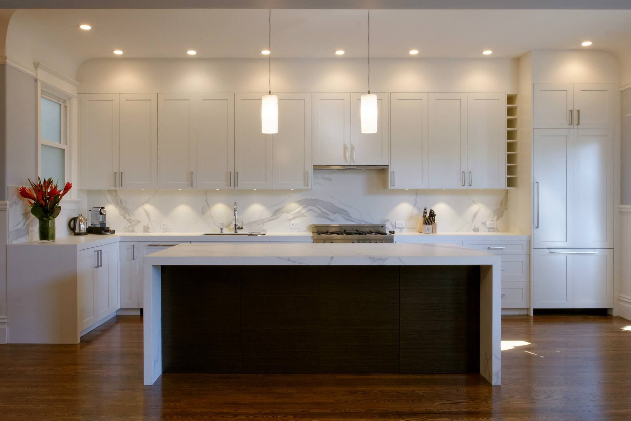 Modern Kitchen Design. Great Lighting With White And Brown Colour Scheme.  Working Wonderfully. Very Creative