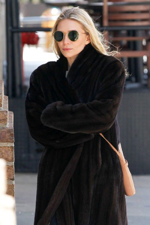 The fur coat and the round sunglasses make for a great winter out ...