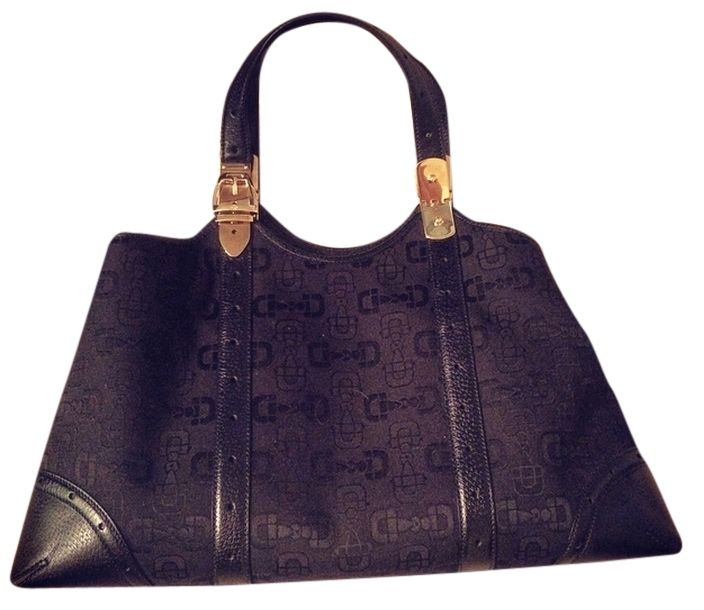 327593bff99 Gucci Classic Leather And Canvas Shoulder Bag. Get one of the hottest  styles of the