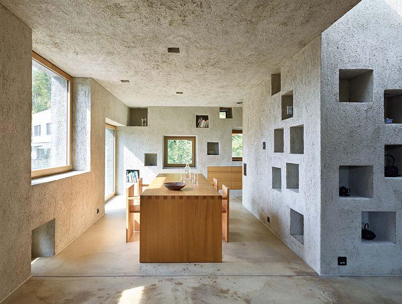 Concrete House In Switzerland Looks Like A Block Of Swiss Cheese Curbedclockmenumore Arrow With Square Holes That Concrete House Concrete Houses Architect