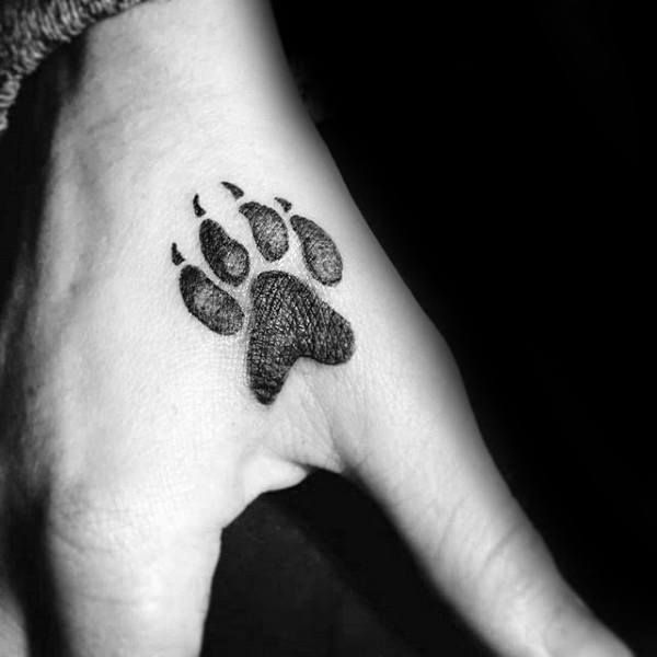 50 Wolf Paw Tattoo Designs For Men Animal Ink Ideas In 2020 Hand Tattoos For Guys Small Hand Tattoos Small Tattoos For Guys