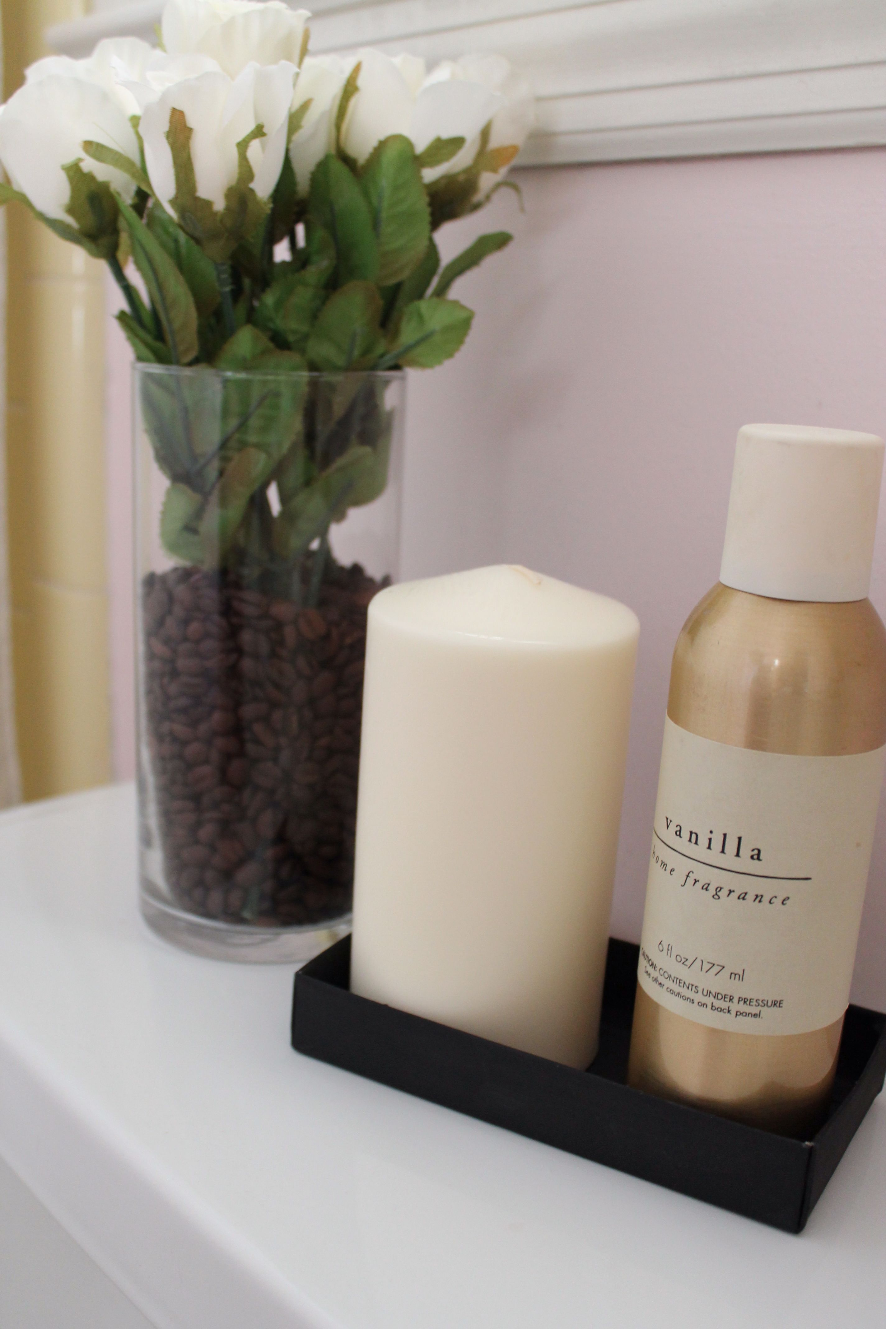 Coffee beans in the bathroom. Spray paint any little box & fill it with candle & spray!