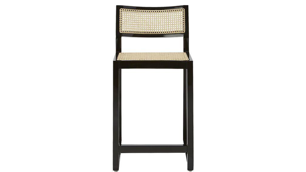 Shop makan mahogany bar stools.   Designed by David Irwin, bar stool proudly sits at the crossroad of past and future, combining traditional caning and mahogany wood lacquered in hi-gloss black.