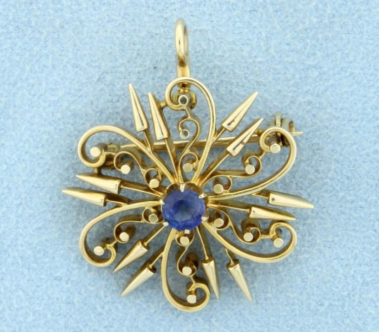 This stunning Antique pin/pendant combination is set in 14k yellow gold with a fabulous blue gem color Sapphire at the center.  This Gem Sapphire is 4.5mm in diameter and totals approximately a 1/2 carat!  Great look and condition and this Sapphire is still very blue.  6.9g
