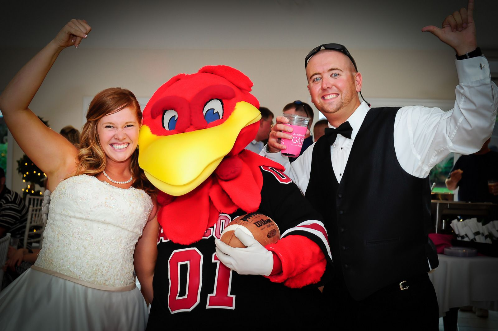 """Submitted by Stephanie Arrowood: Josh and I got married a few months ago and knew that Cocky had to be there to share in all the fun! This shot made the """"The Carolina Bride Summer/Fall"""" for this year. Photo by Judy Kay Bryan. We also had our engagements done at Williams Brice. GO COCKS"""