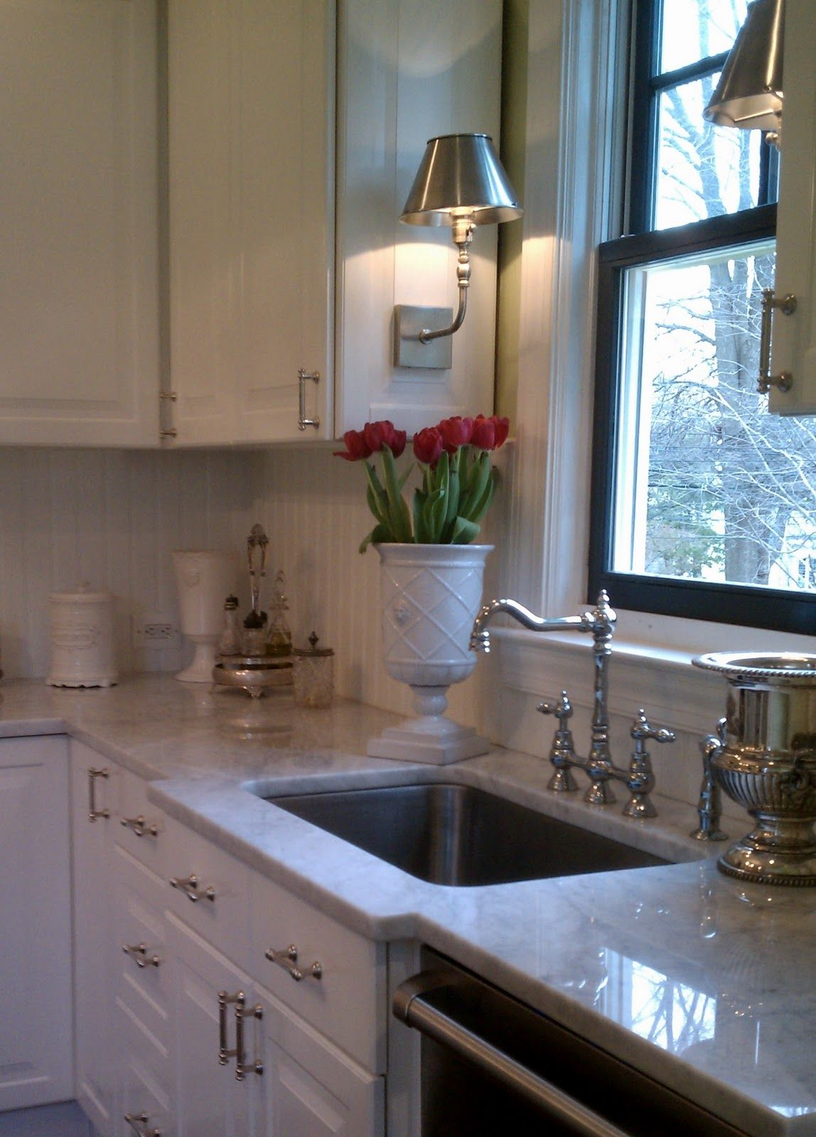 A kitchen layout exactly like minelove those sconces over the sink